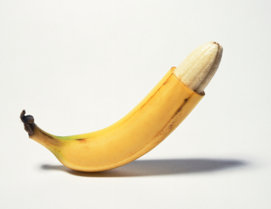 Banana in the peel with the top portion of the peel sliced off to mimic circumcision