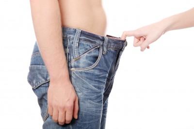 woman-looking-down-man's-pants.jpg