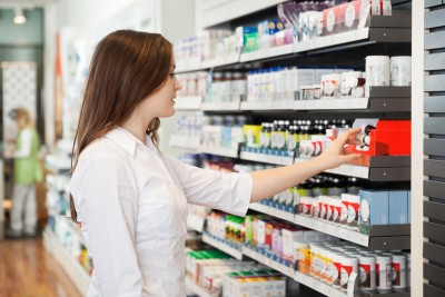 woman-in-pharmacy-selecting-medications.jpg