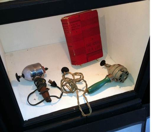 Two antique vibrators on display in a sex museum