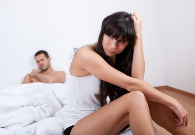 Couple in bed questioning whether it was a good idea to sleep together
