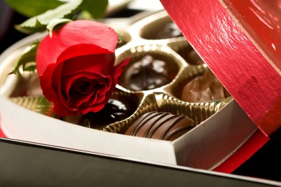 Valentine's Day box of chocolates with a red rose