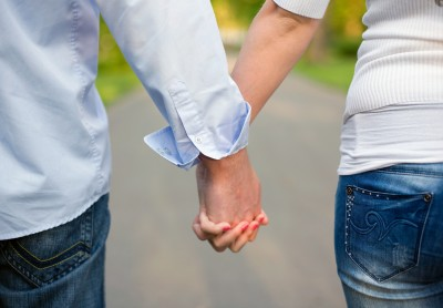 young-couple-holding-hands.jpg