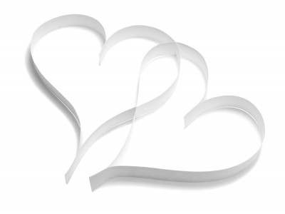Two paper heart cutouts interlocked together