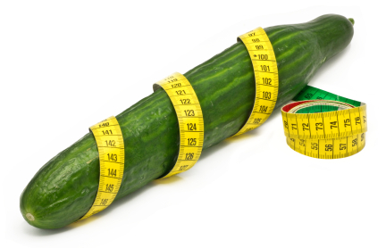 Cucumber wrapped in a measuring tape to symbolize penis size