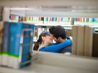 College students making out in the library stacks.