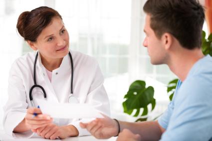 female-doctor-talking-to-male-patient.jpg