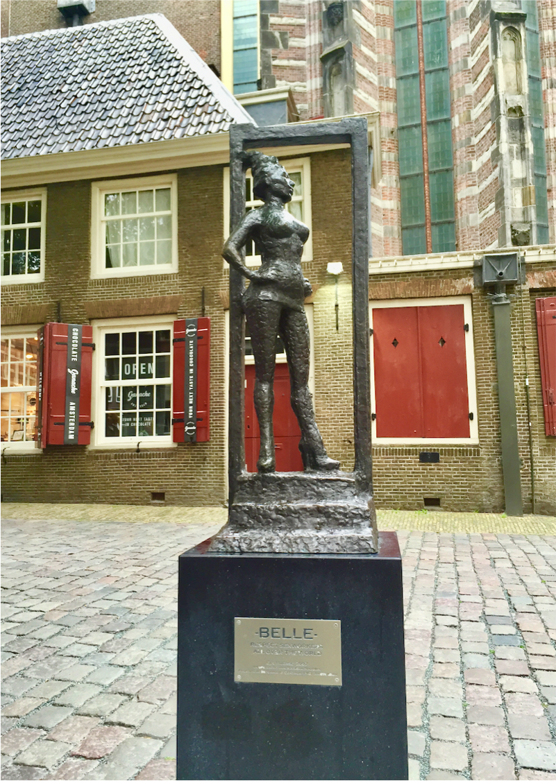 """This is Belle. She is a monument to prostitution in the heart of Amsterdam's Red Light District. The plaque below her reads: """"Respect sex workers all over the world."""""""