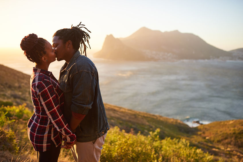 African American couple kissing passionately. Romantic scenery.