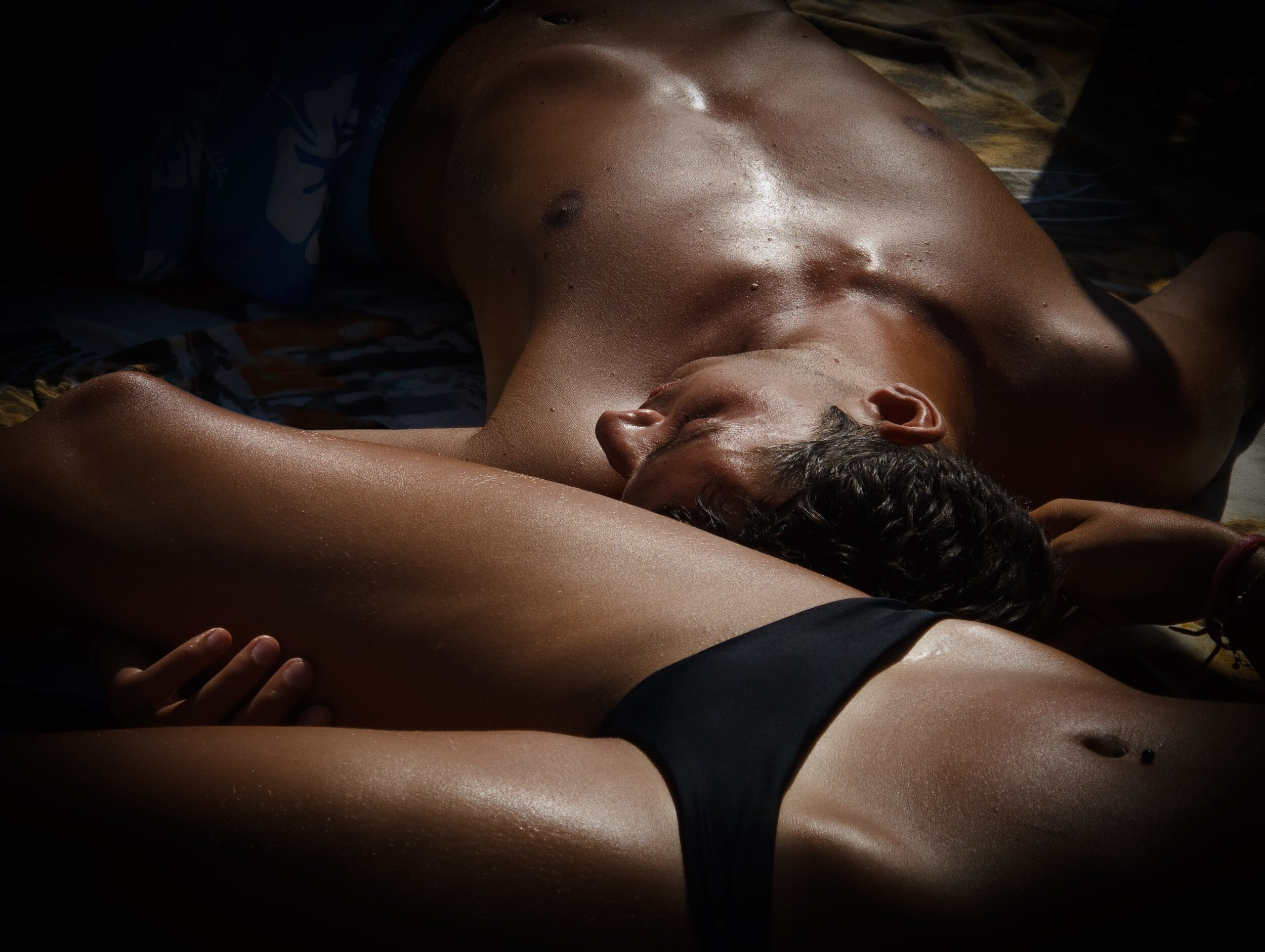 Man and woman lying together naked.
