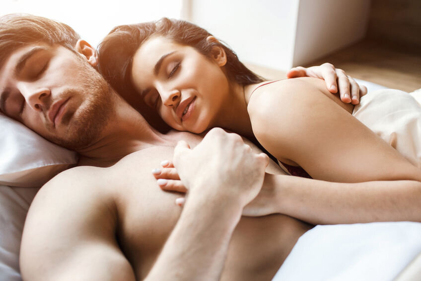Couple in bed after sex. Sleeping and dreaming.