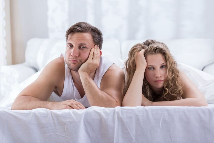 Couple bored in bed.