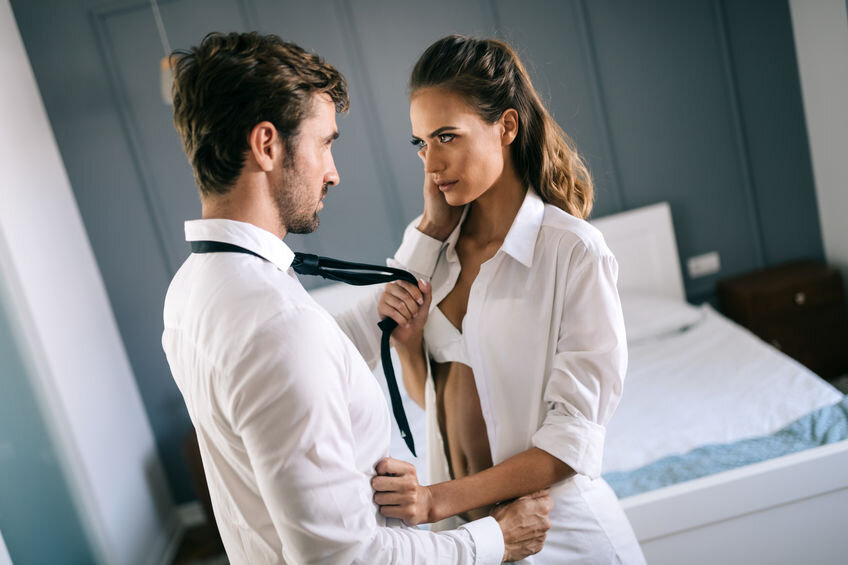 Couple getting ready for rough sex. Pulling on necktie.