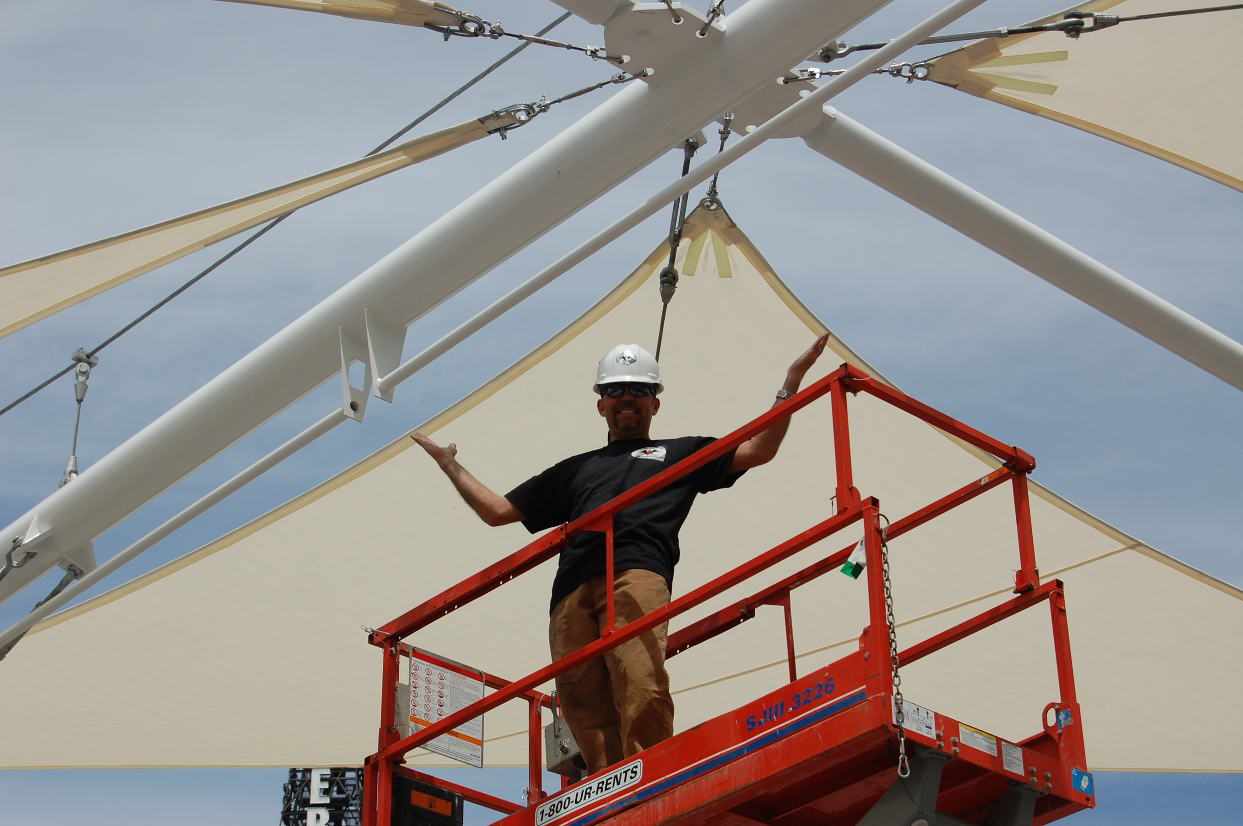 Tres installing the sails at the Gallivan Center