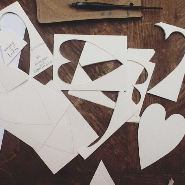 cutting heart shapes // 2014 valentines; image by hello, bird.