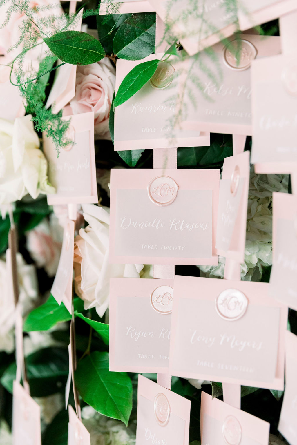 vellum escort cards with wax seal by hello, bird. // photo courtesy of carly michelle photography