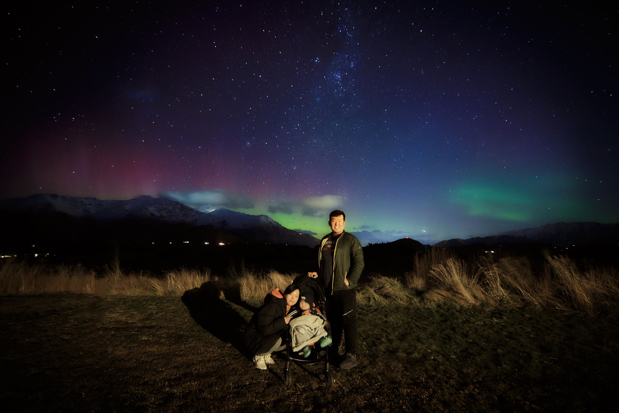Backyard family selfie on a night with an aurora.