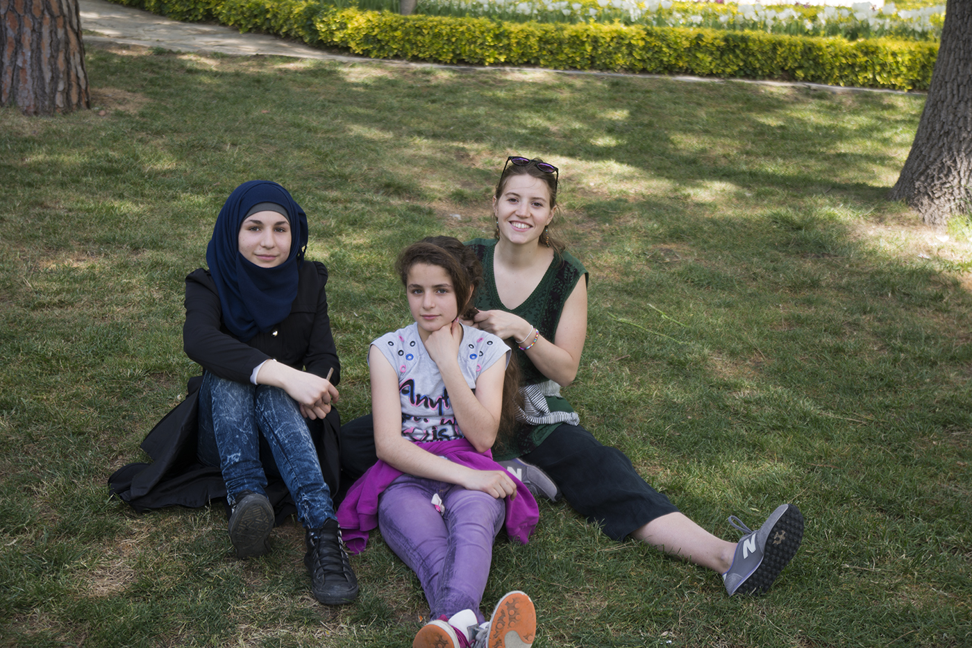In this photo, Beatrice is sitting with Ravan, age 13 and her younger sister Cuud, age 12. Both of these sweet girls can speak a little English, more than other students in the class. This was Beatrice's last outing with the kids and a nice time to really connect, braid hair, and relax at Emirgan Park.