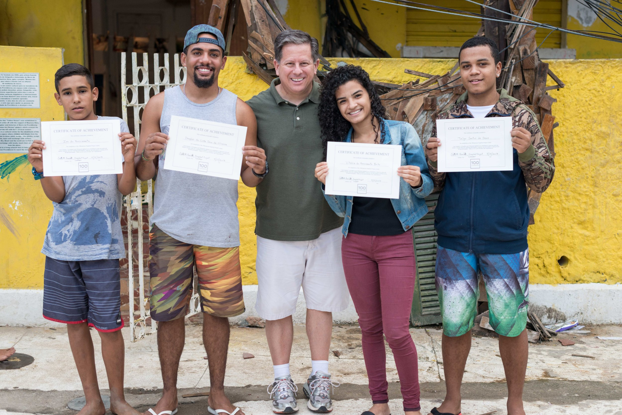 Scott Bennett pictured here with students proud to show their graduation certificates.
