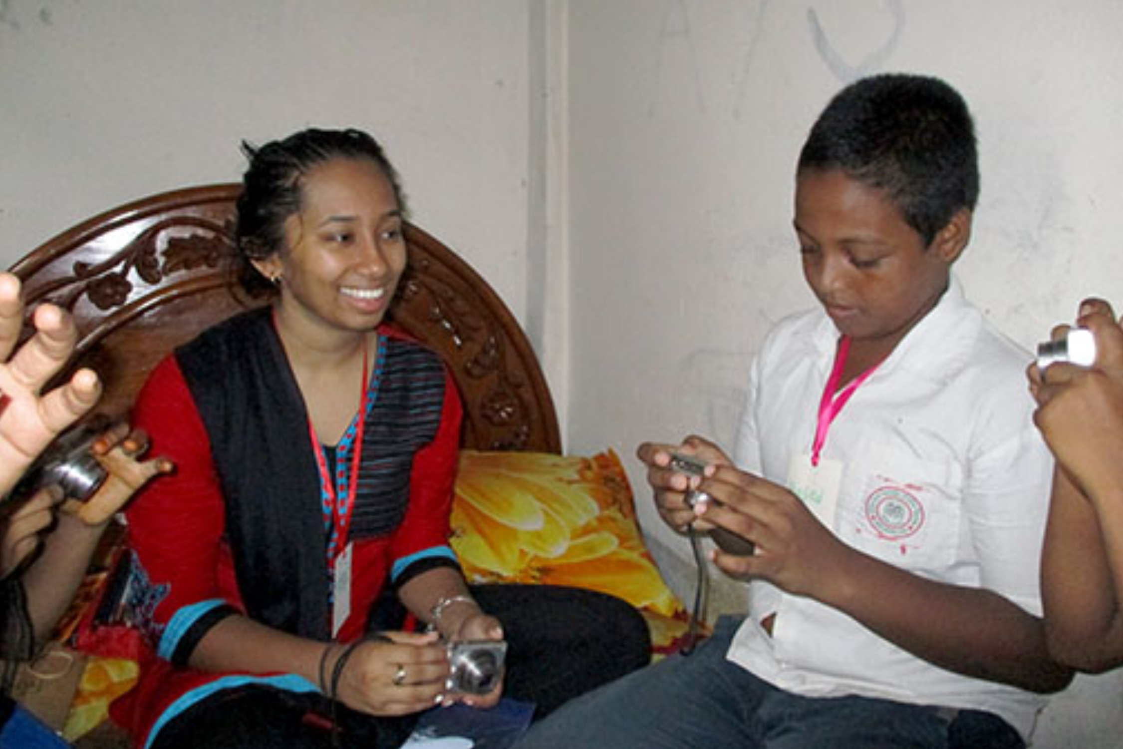 Mehran covers camera settings with her group, taken in one of the students' family home in the Nuru Chala neighborhood.