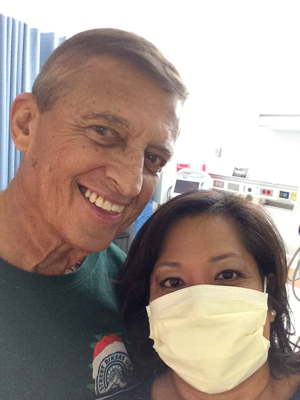 My husband and I at The Queen's Medical Center. I had to wear a mask to keep from giving him any germs.