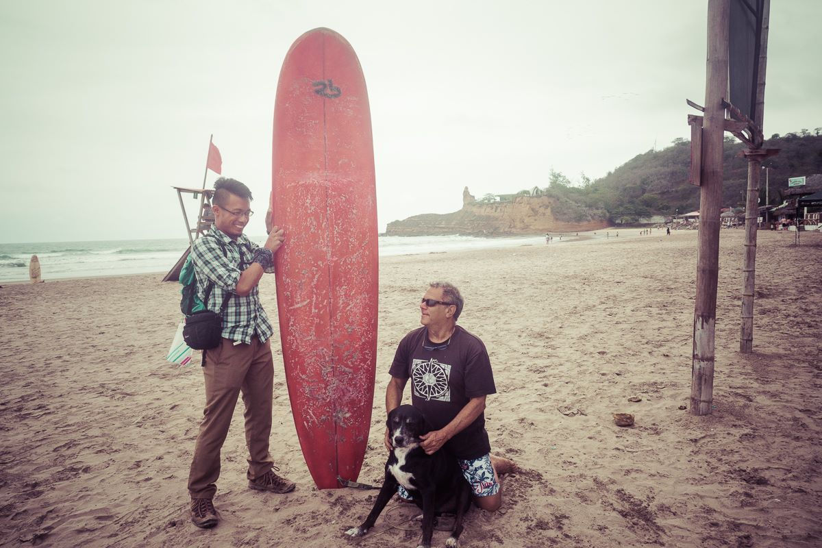 A candid moment with Oscar, my surf instructor from Costa Rica, and his dog Wili (Montañita, Ecuador)
