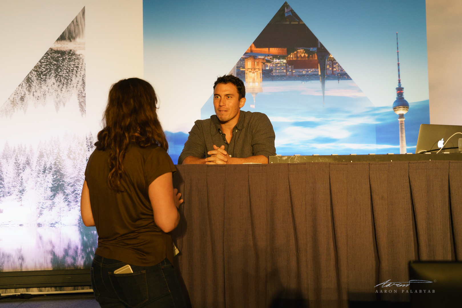 Chris Burkard speaking with one of his fans before the start of the talk