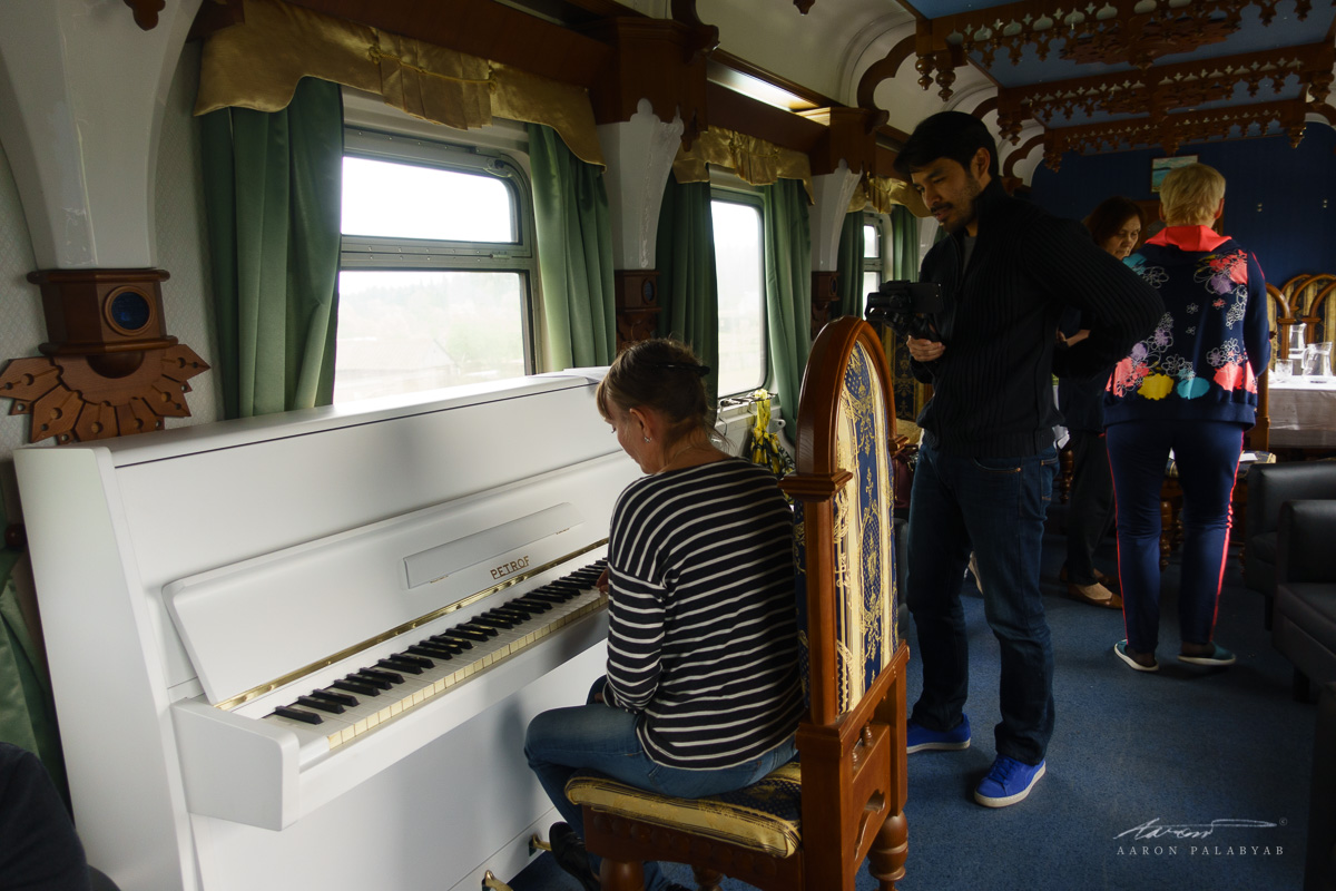 At the lounge car learning Russian songs