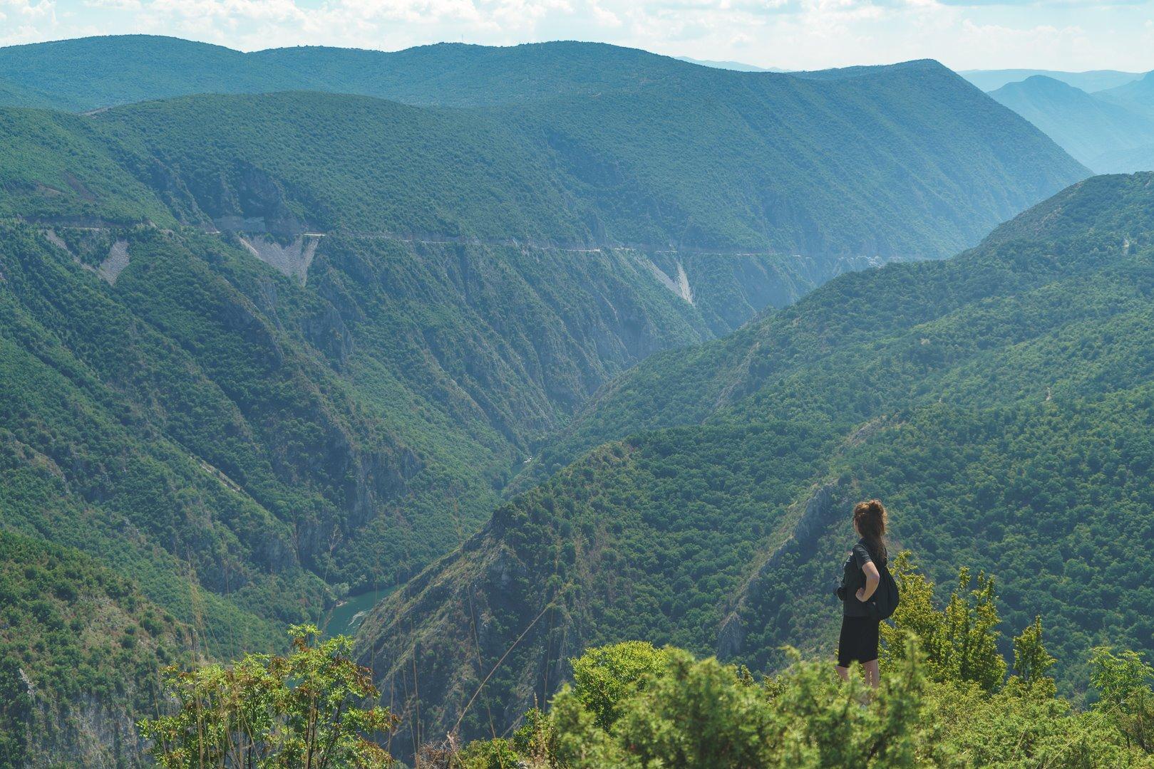 Polish artist Agnieszka Rowińska looking down at Canyon Matka on the 30km Vodno-Matka traverse in Macedonia (FYROM)