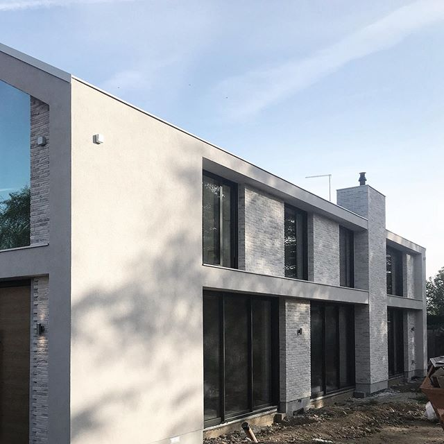 Nearing completion.. a light grey brick and rendered project with double height glazing for the clients.