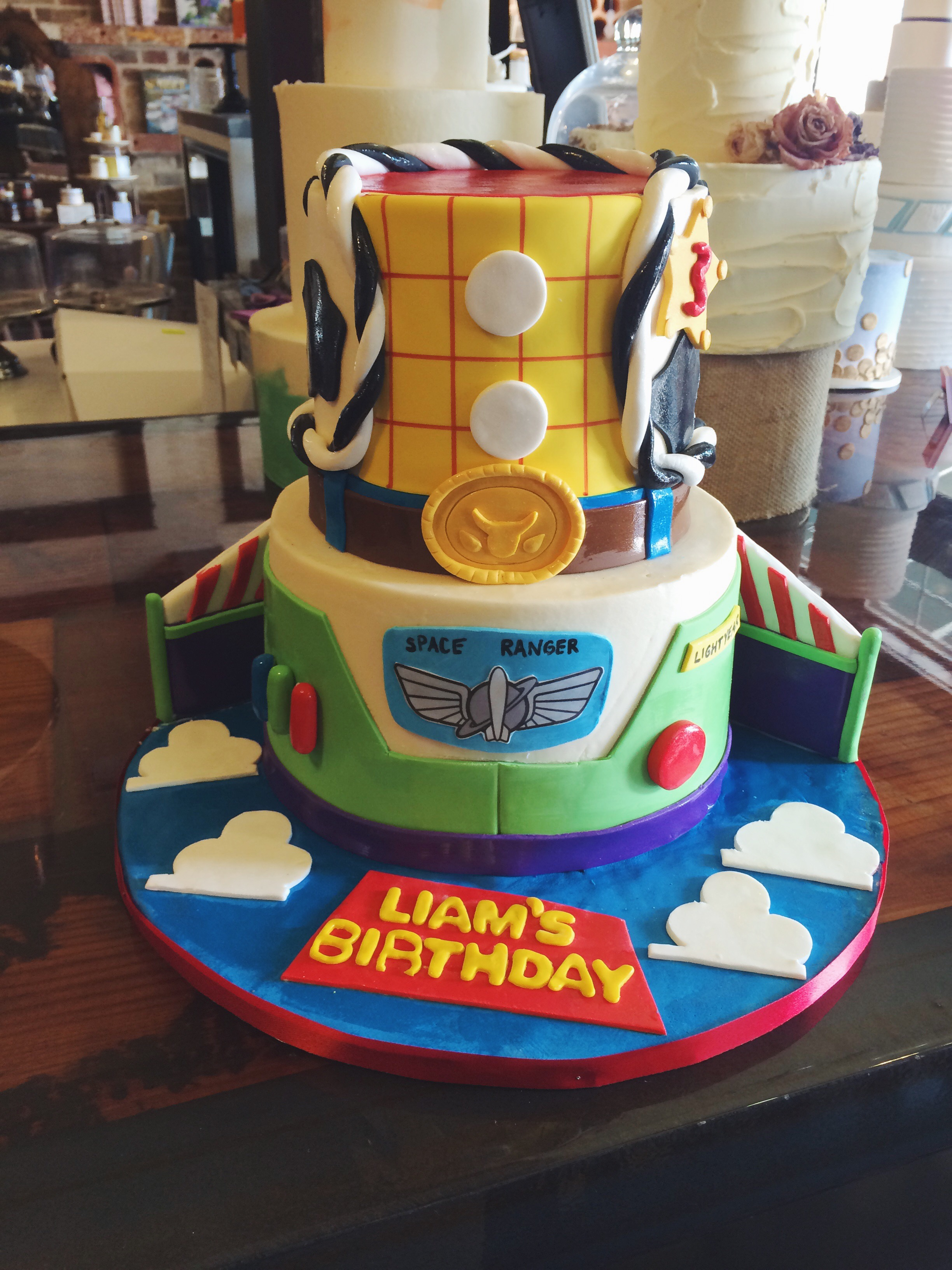 Toy_Story_cake_two_tier_Kids_Birthday_Woody_Buzz_Lightyear_Party_Fondant_SugarBeeSweets.JPG