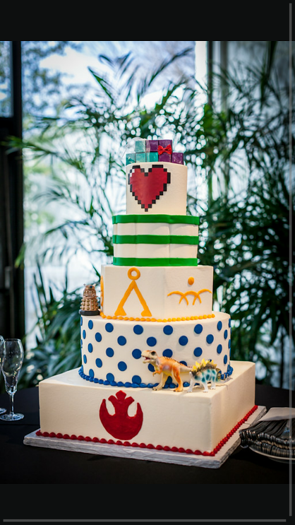 Custom_Colorful__Buttercream_wedding_cake_Zelda_Nerdy_gaming_Dinosaur__Triforce_SugarBeeSweets_.png