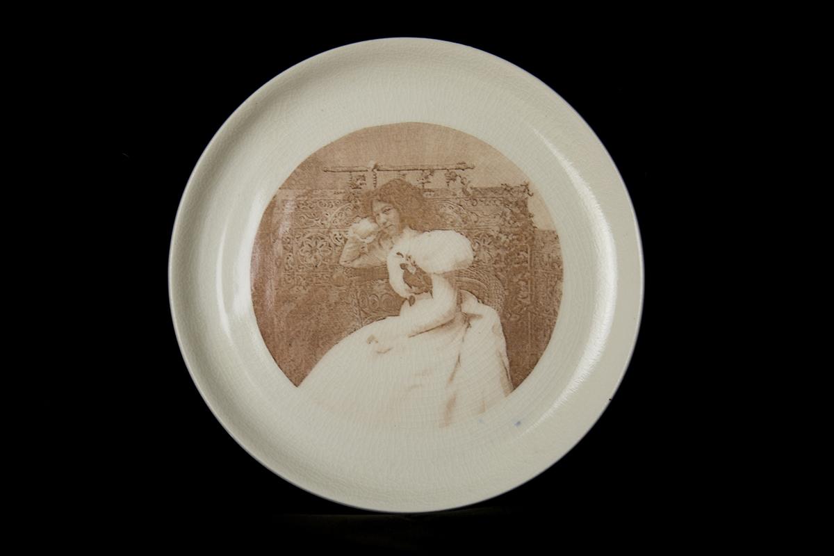 "Ida Lange  2016. Glaze and fired-on decals on porcelain. - 8.5"" diameter"