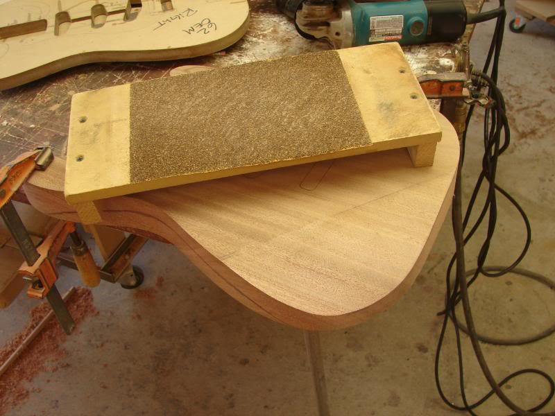 So once it's roughed out, I use my high precision contour shaping tool with 32 grit.