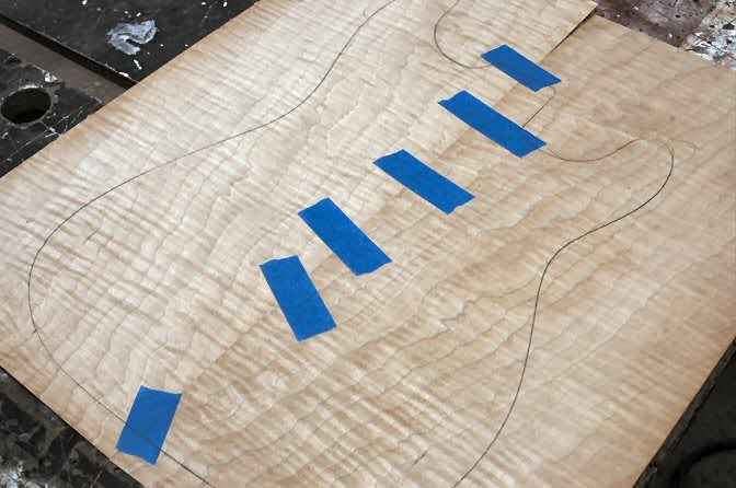 Now match the veneer's edges and tape it into one sheet. Then roughcut the shape out of the veneer. Use scissors, X-Acto knife, whatever….