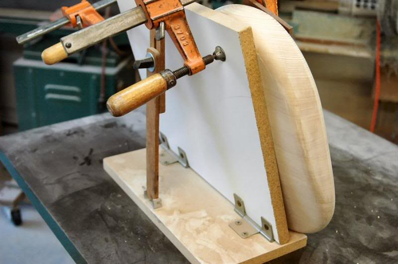 There are 2 ways to finish the contour, one is with a spindle sander. I have made a jig to hold the body at the correct angle. This is the quick easy way.