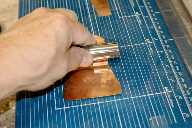 Then using a special tool, one that is a trade secret, so it's even called by a fictitious name to keep it from being commonly known, this one is called a Craftsman Deep Well ¾ inch socket… is that cool or what, who will ever figure that one out? I flatten all the copper by burnishing it.