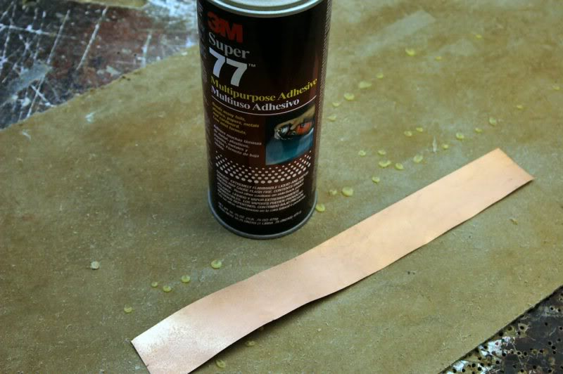 Then apply adhesive to the back side of the walls. This holds it in place until it's soldered.