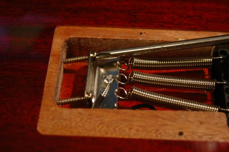 You don't go over board, because as you tighten the spring claw, it pulls the strings to a higher pitch, when you retune, lowering the pitch, and the tension, the tremolo witch assume a new position, hopefully the correct one. It is a simple balancing act, the tension of the strings pulling against the tension exerted by the springs.