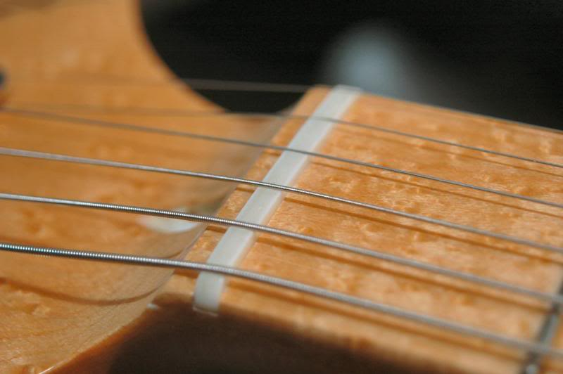 Replace the strings and the pressure will seat the nut.With that, this baby's done.