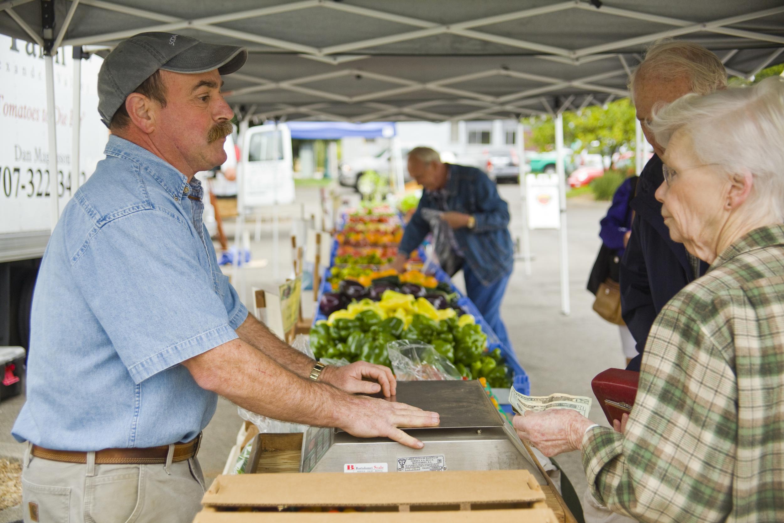 Dan helping customers at the farmer's market.