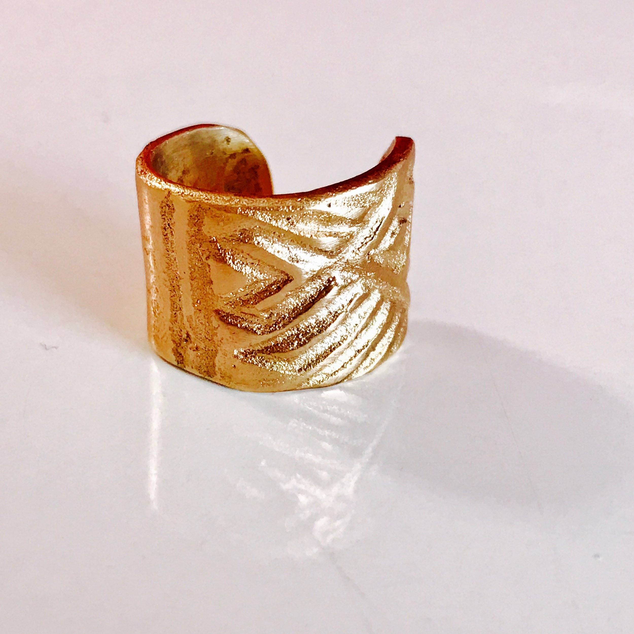 This stamped bronze ring and a double wallet is available at Almanac of Style in a special edition.   https://www.almanacofstyle.com/collections/accessories?page=2