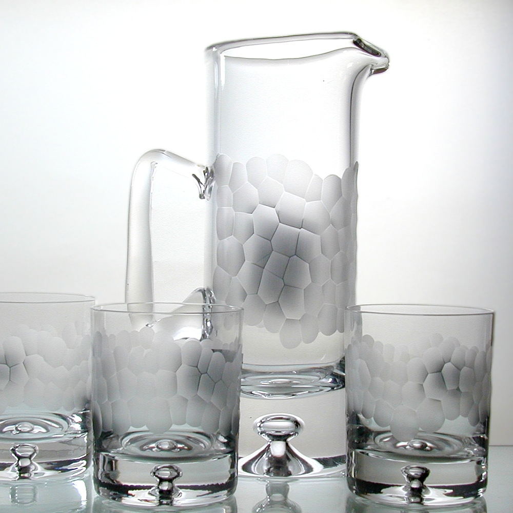 Handcut Pebble Design glass tumblers with a handcut Pebble Design glass Jug.