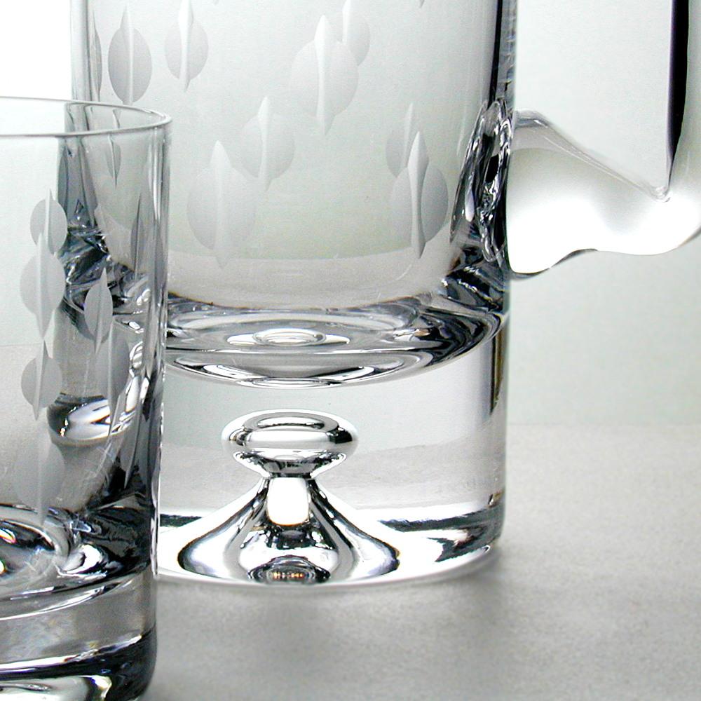 Hand Cut Kiss Design glass tumblers with a hand cut Kiss Design Jug.
