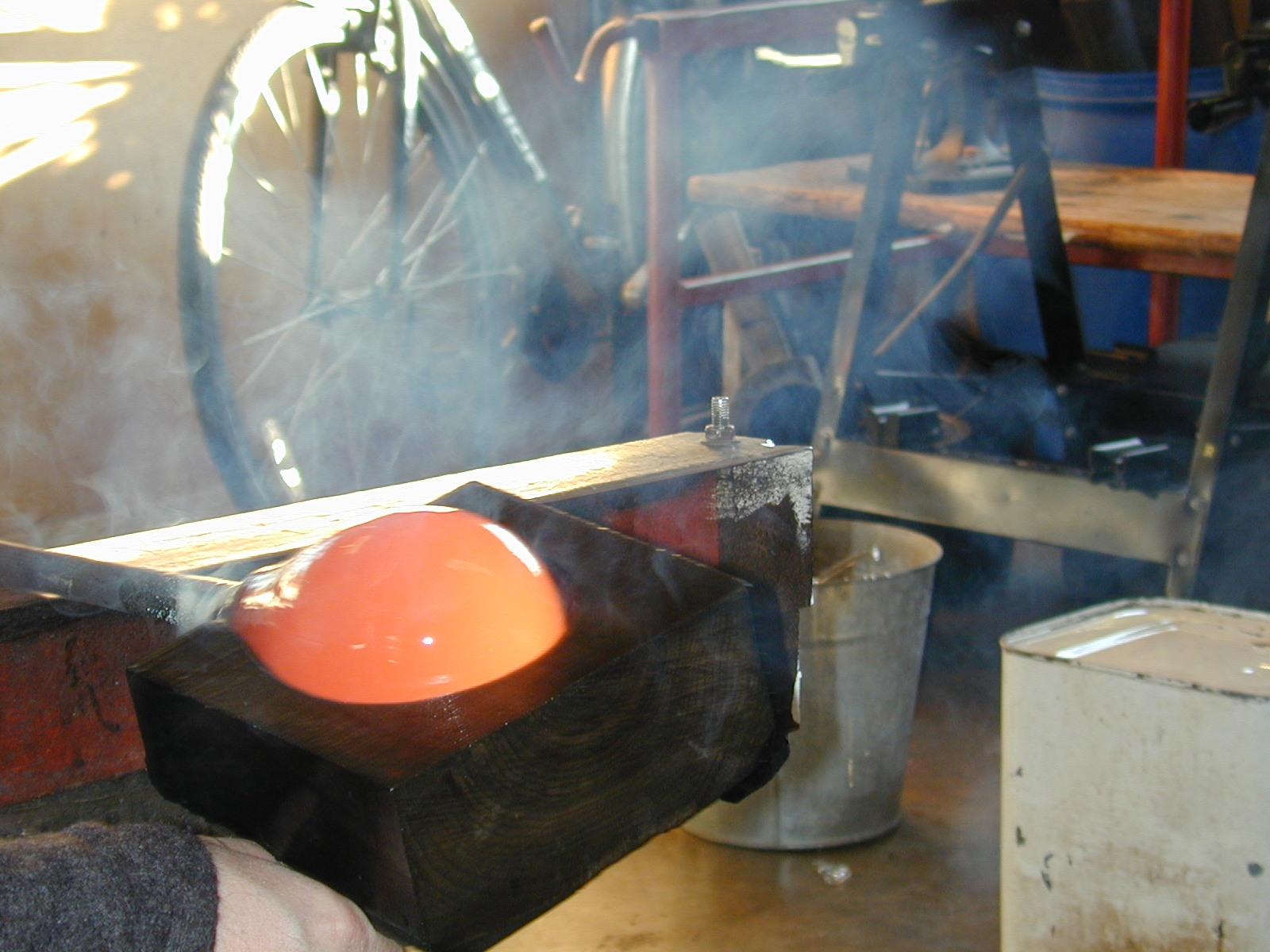 Shaping hot glass with a wooden block