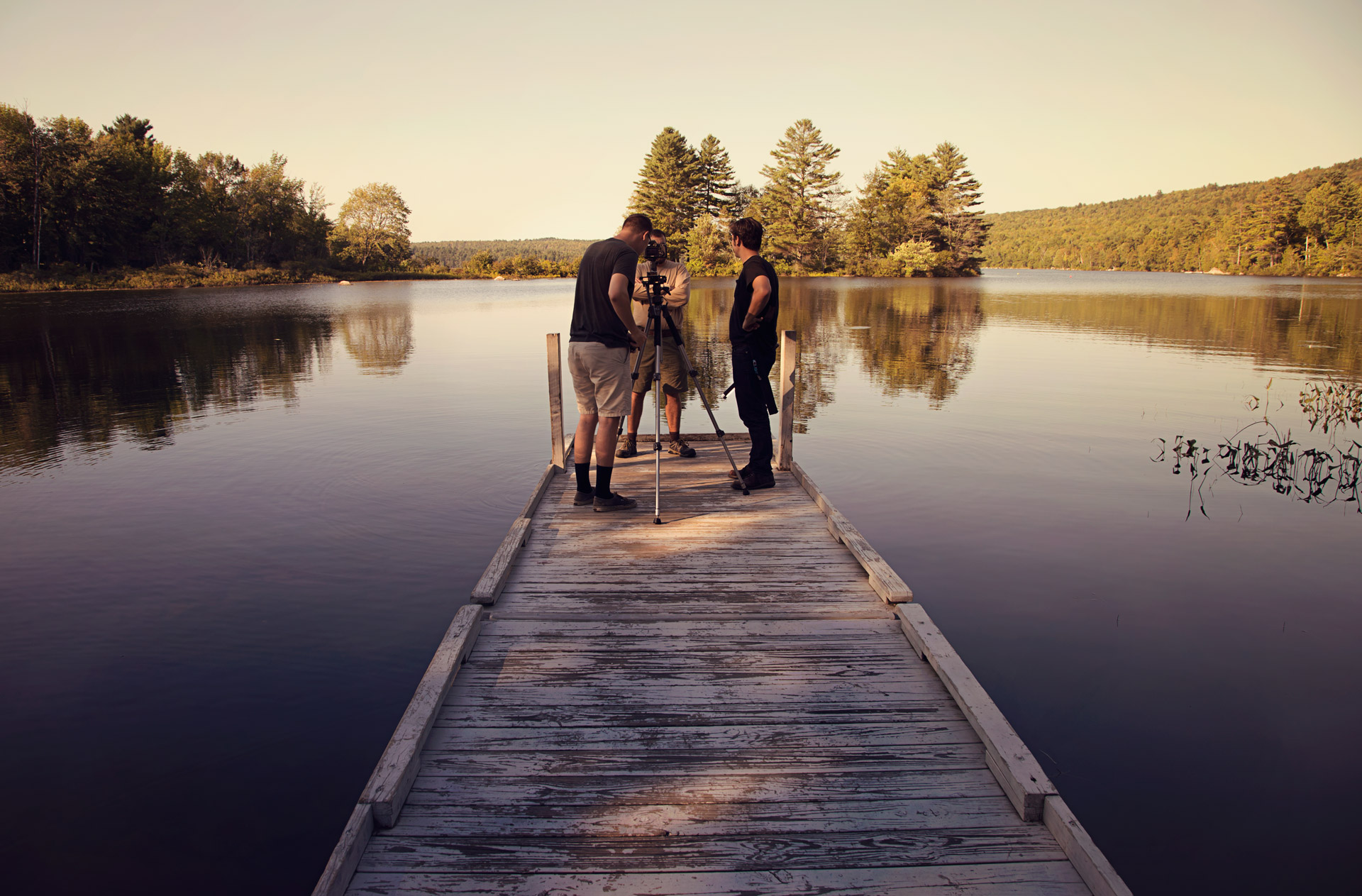 guys-standing-on-dock-filming-on-a-lake-maine-parisleaf.jpg