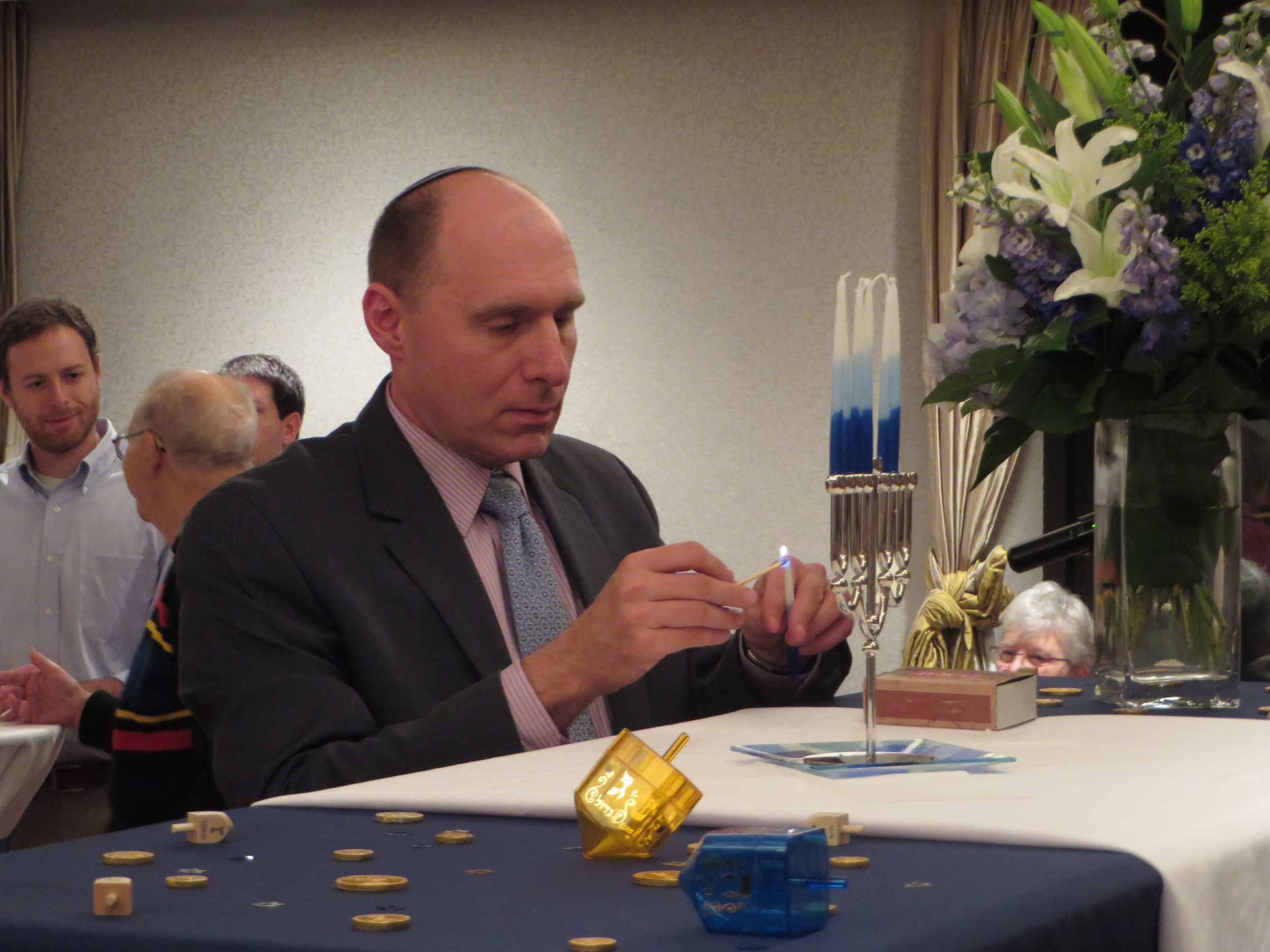 Alan Ronkin, Director, AJC Washington, D.C., lights the candles of the Menorah