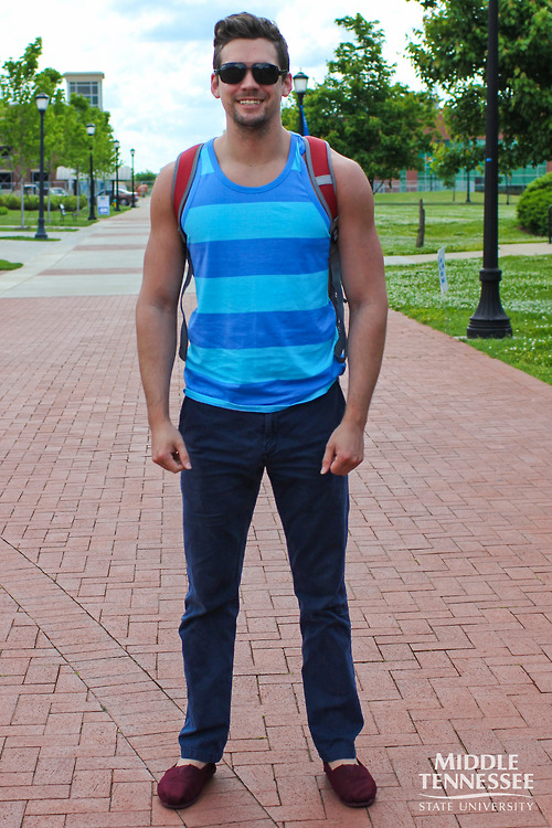 Middle Tennessee State University student wears a summery horizontal stripe two tone blue tank blue chinos and burgundy red toms slippers