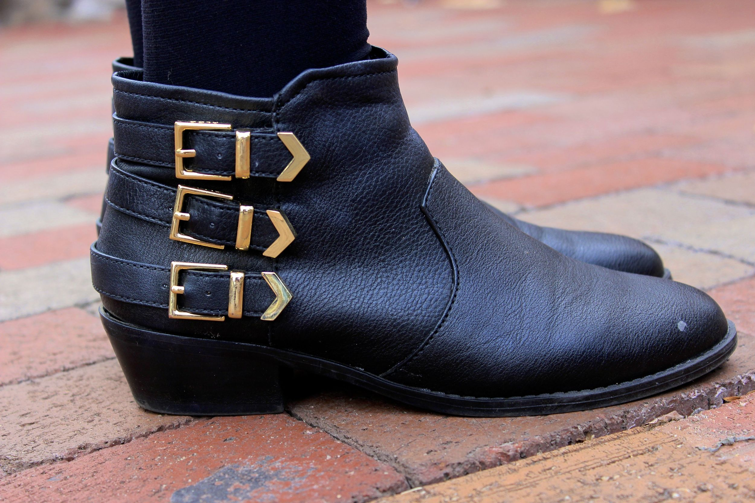 Black Leather booties with golden buckles. College University style
