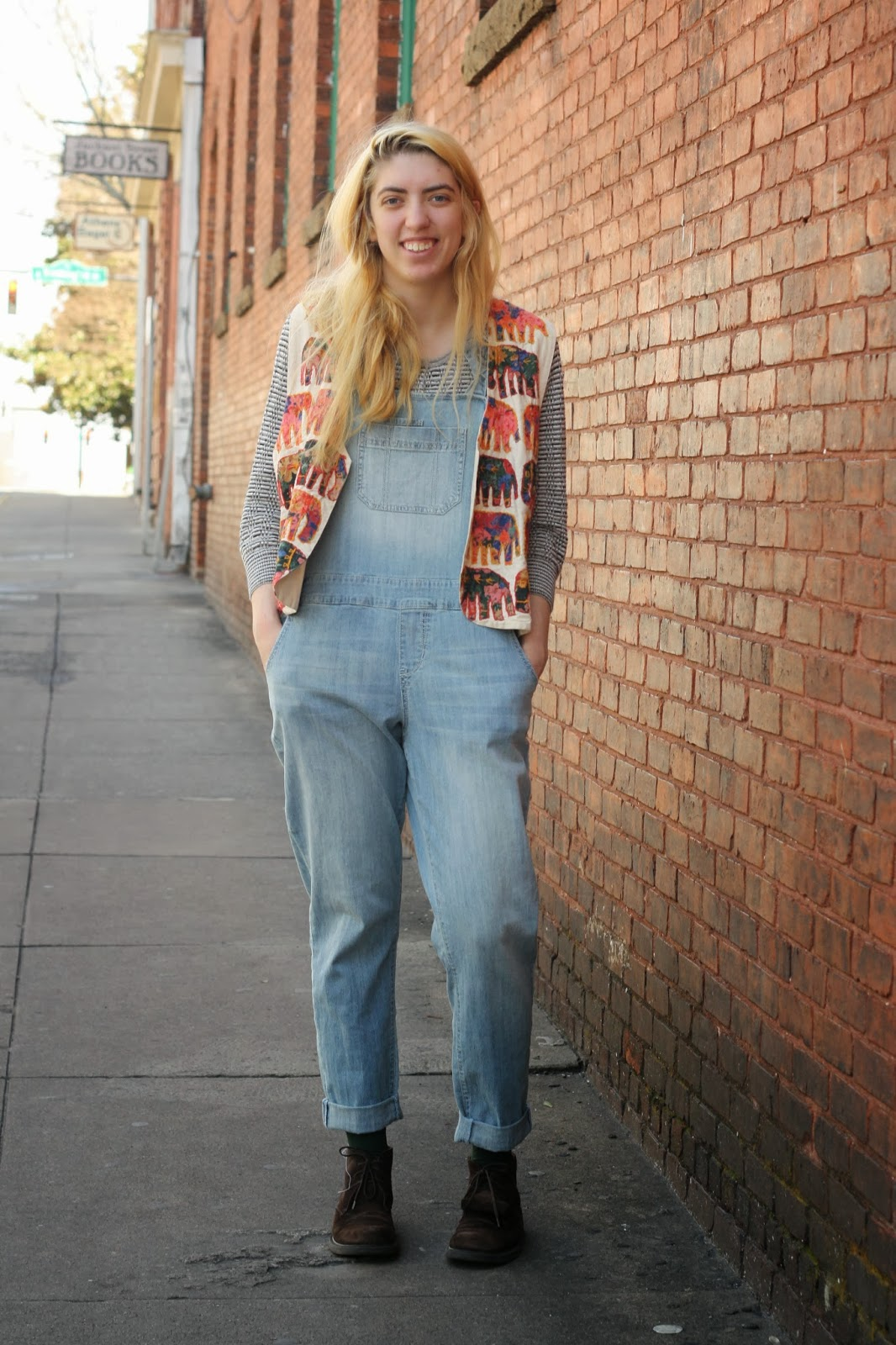 Maddie Zerkel - UGA Athens Street Style wears American Rag jean overalls with J.Crew boots and an elephant cardigan